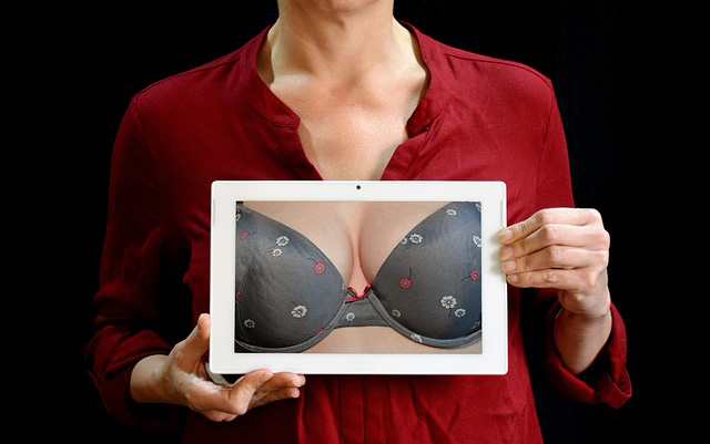 Woman Holding Picture of Bra