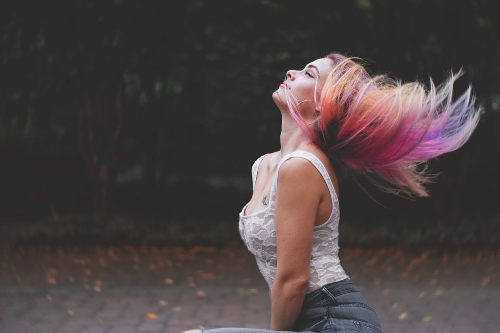 Girl flaunting rainbow colored hair