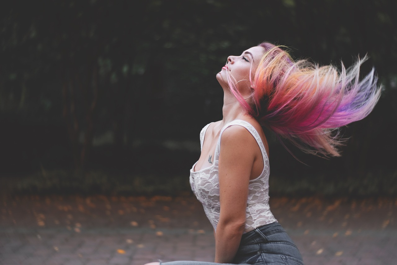 Woman flaunting rainbow colored hair