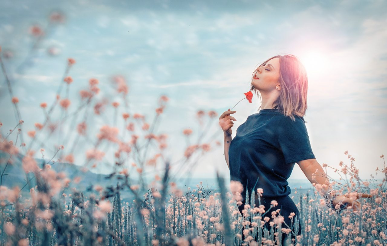 Woman embracing nature in Field of Flowers
