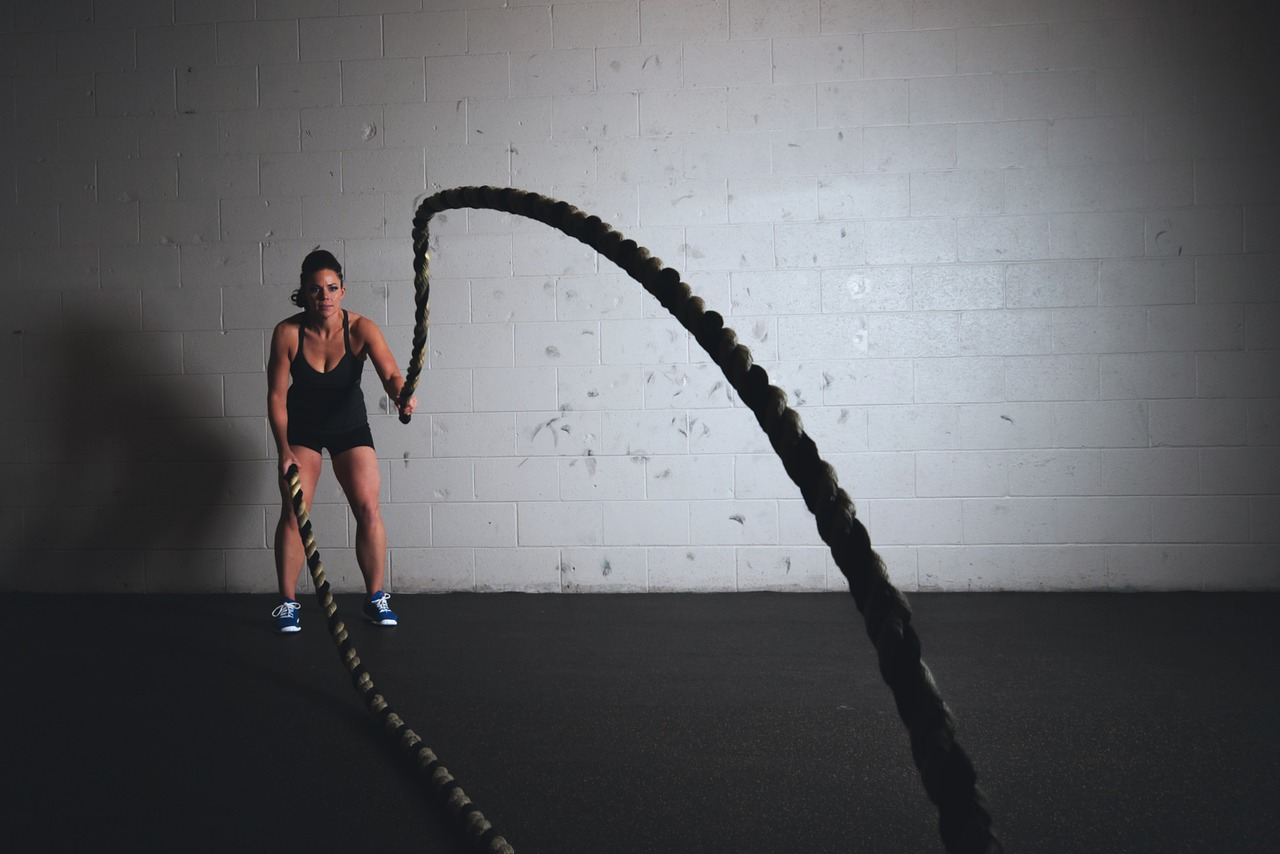 Girl working out with ropes