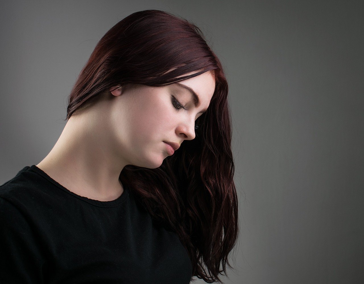 woman with dark hair thinking