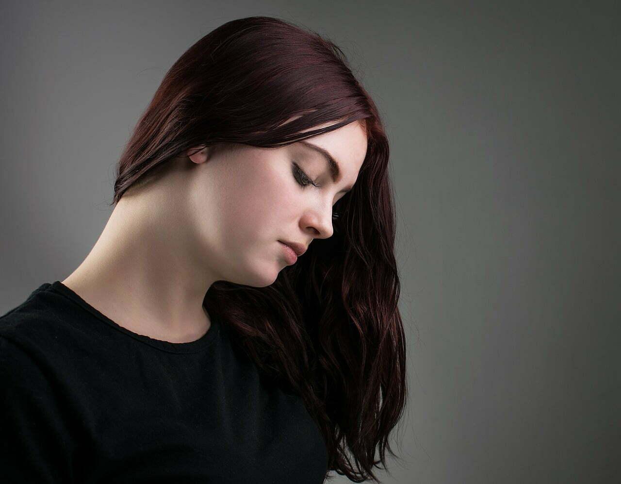 woman thinking dark hair