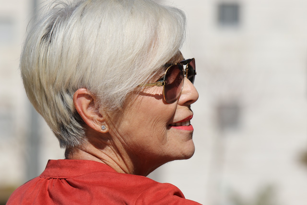 mature woman with sunglasses and face powder