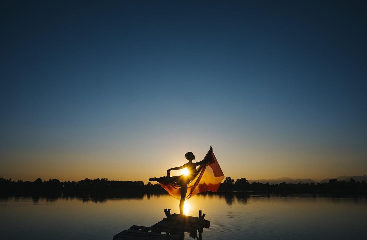 woman sunset lake