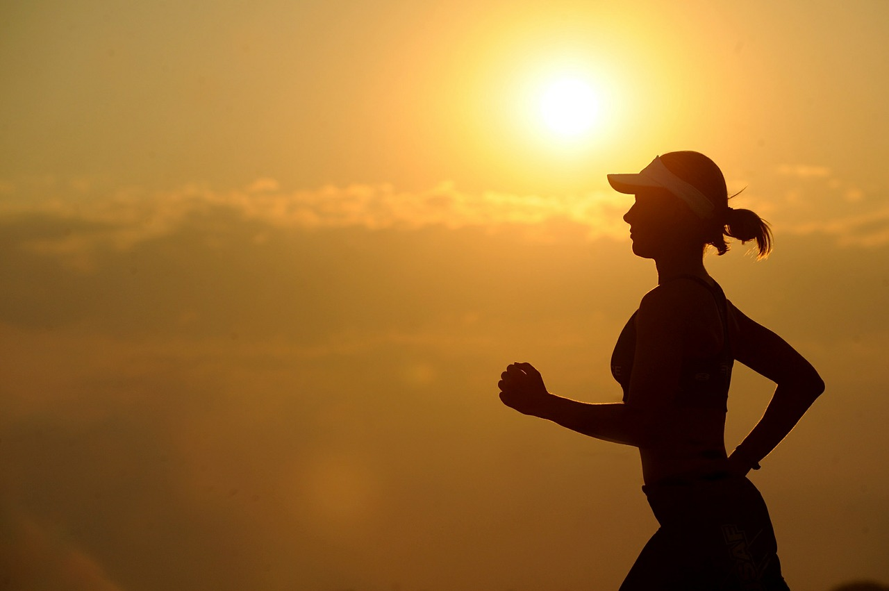 woman running with sun