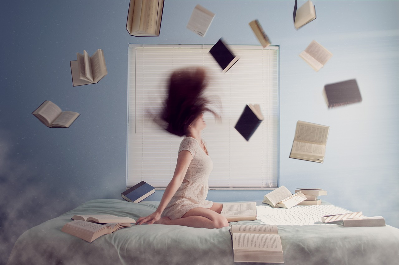 woman on bed with books