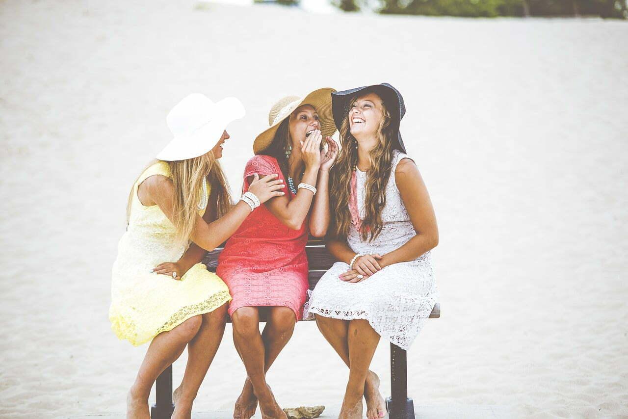 3 women laughing on beach