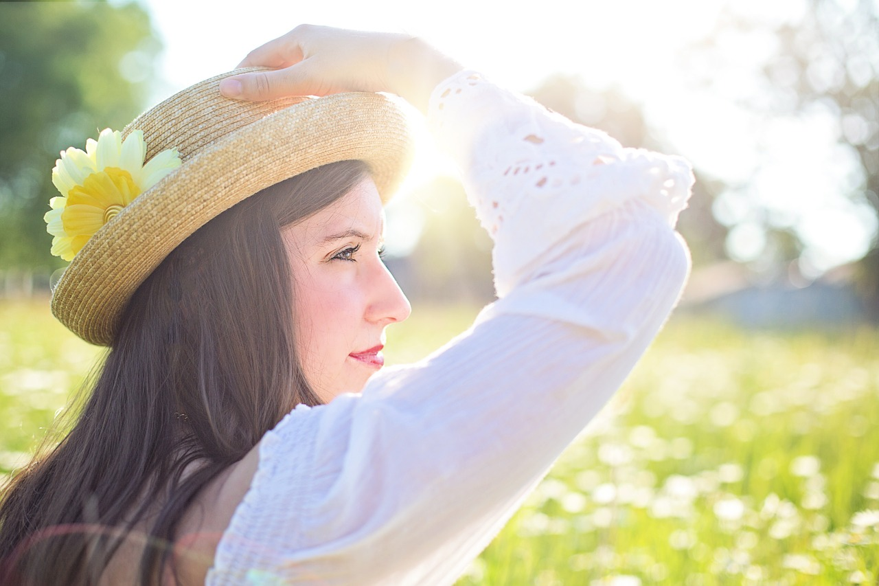 woman in sun hat in field