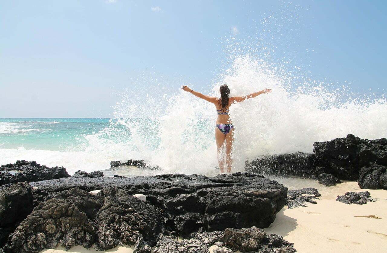 woman wave crashing ocean