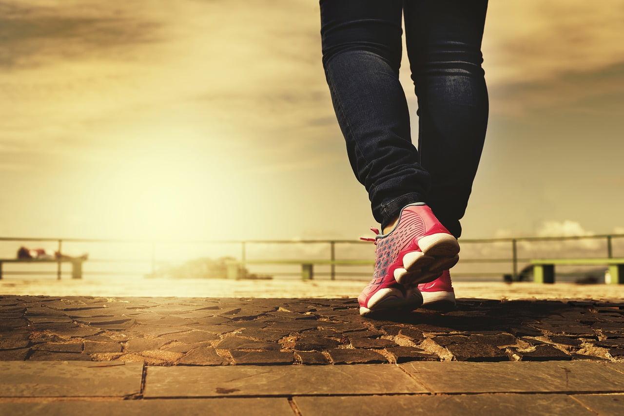 woman walking pink running shoes