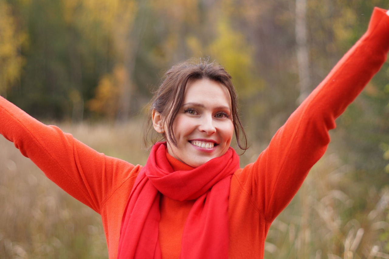 woman happy arms raised