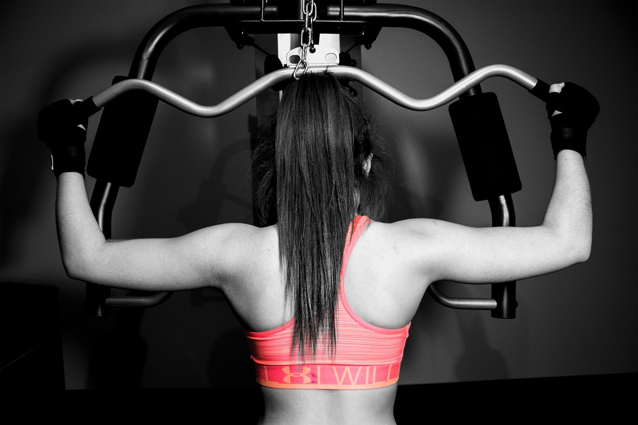 woman lat pull-down exercise
