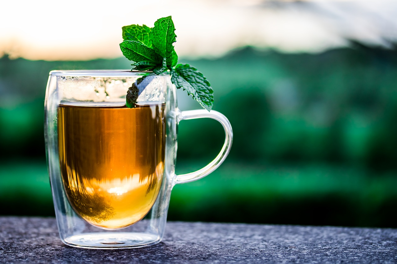 mug of tea with mint leaf