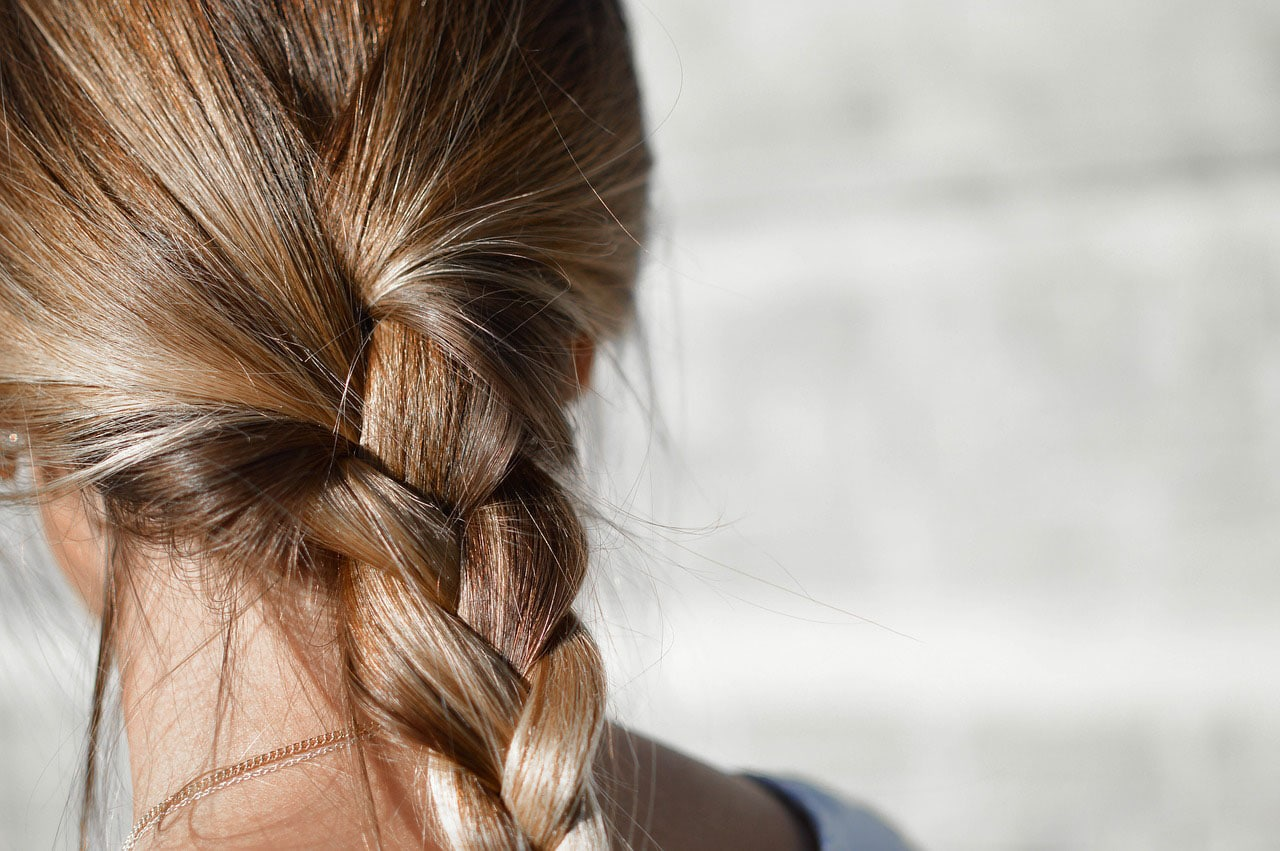 Girl with braided hair in back
