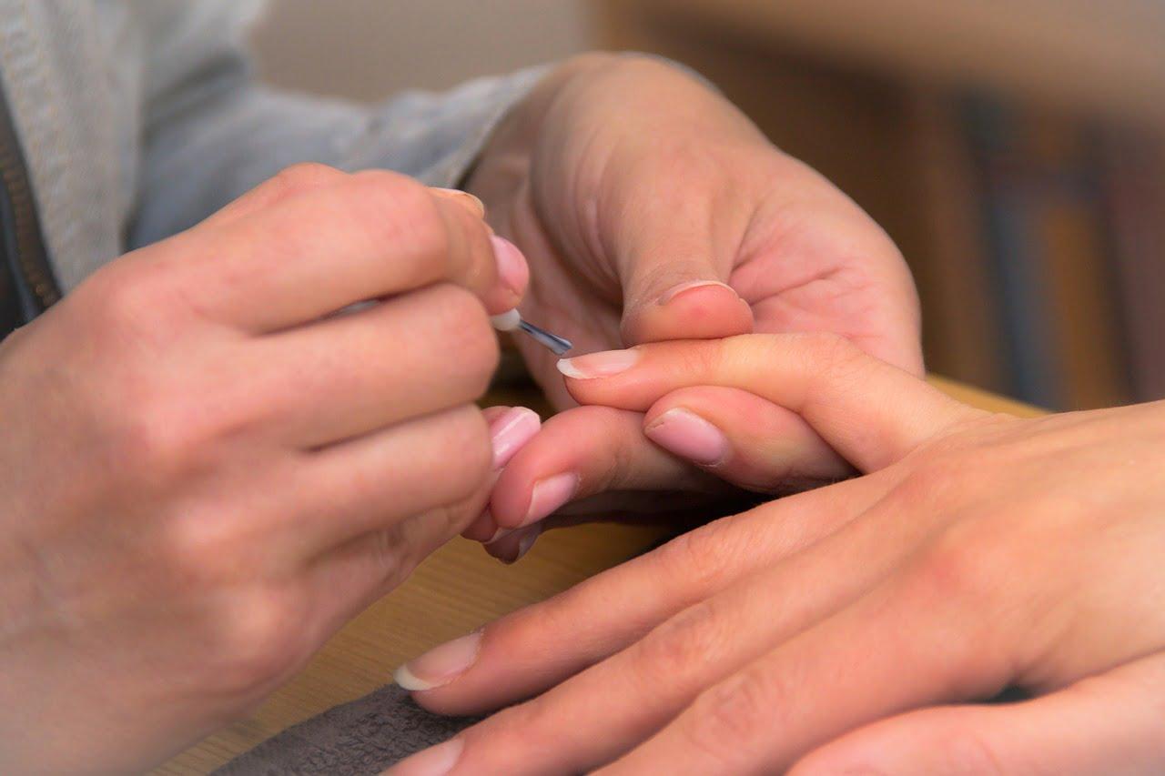 Woman Applying Perfect Nail Polish