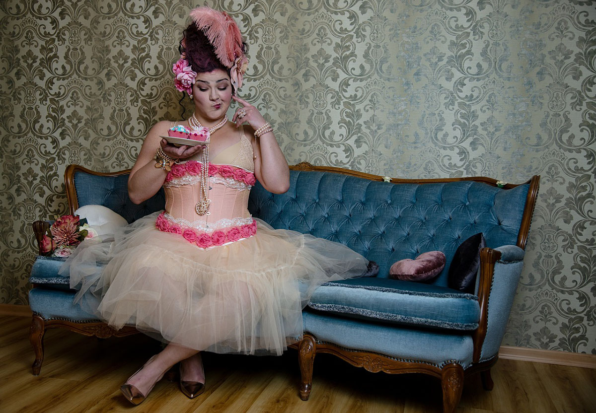 Overweight woman sitting in lingerie