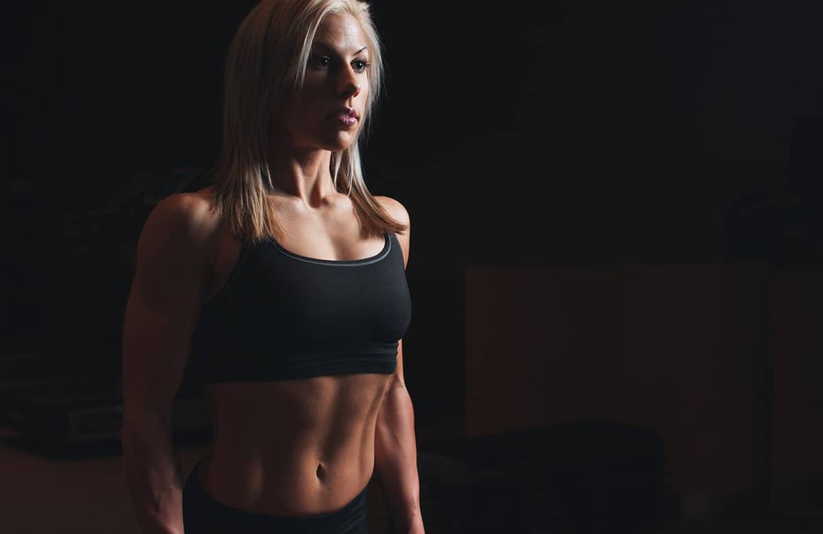 Chesty Woman Posing in Gym Clothes