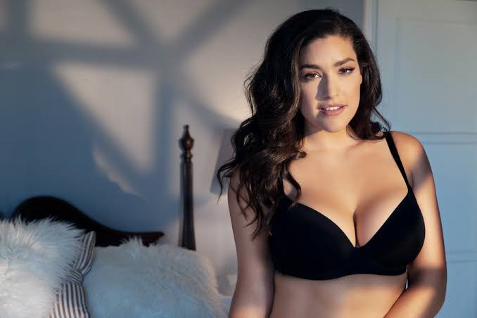 A picture of a woman wearing a black bra