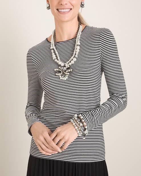 A woman wearing black and white stripnc