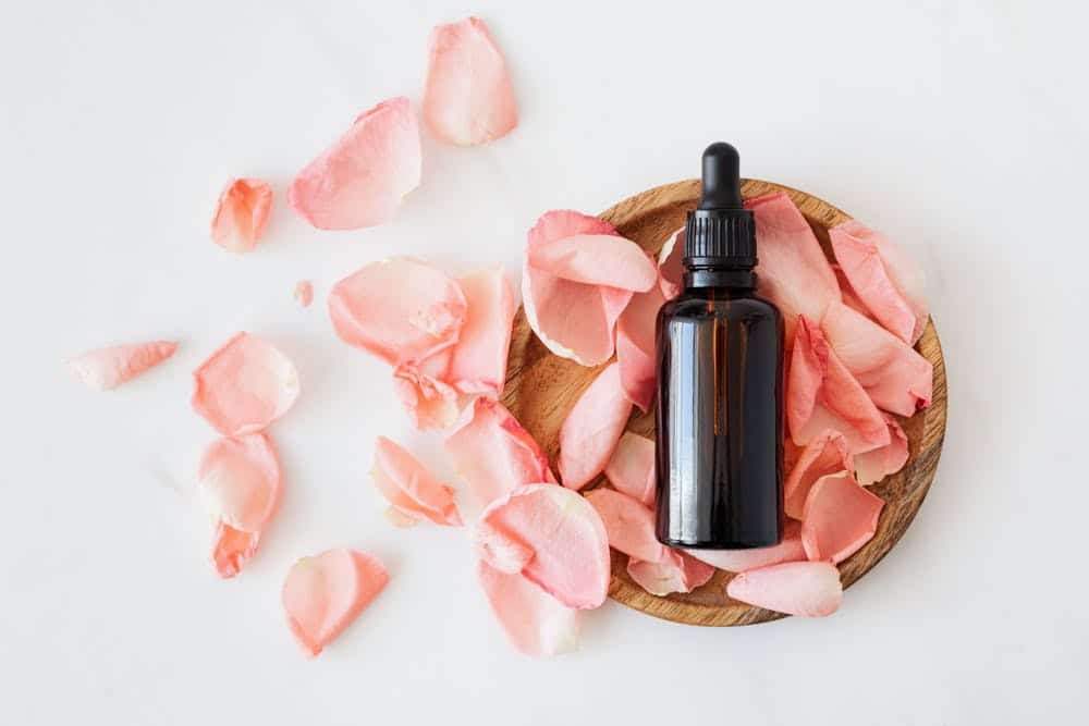 A picture of a bottle of almond oil with flowers