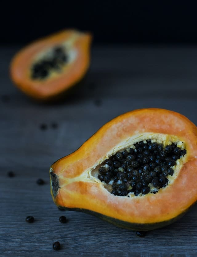 A picture of papaya cut into half